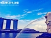 The Singapore merlion with a view of Marina Bay Sands in the background, Singapore, Singapore