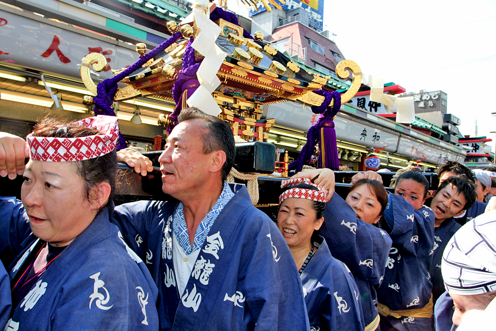 Paraders and carrying a mikoshi (portable shrine)