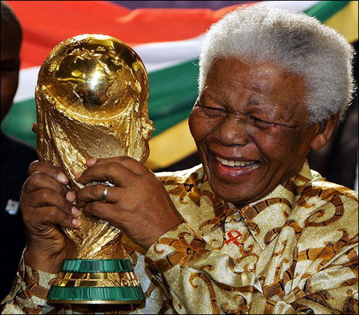 Sir Nelson Mandela holding World Cup during the 2010 FIFA World Cup in South Africa