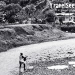 A woman fetches water from a river source in Soufriere, Saint Lucia