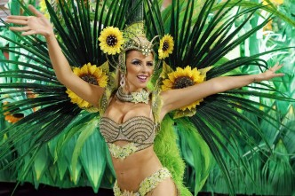 A reveller from the Vila Isabel samba school participates in the annual Carnival parade (c) mirror.co.uk