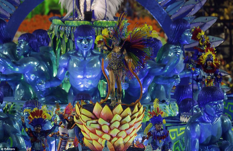 Procession: Various samba schools each have around 3,500 to 4,000 performers. (c) Reuters