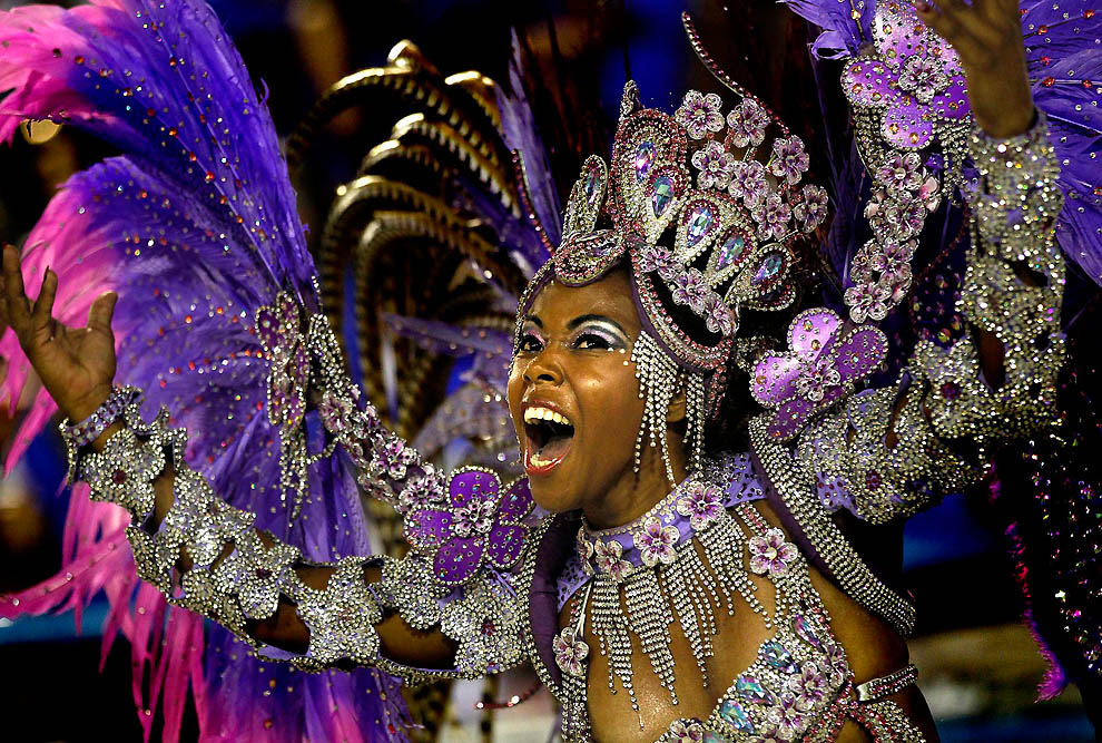 A performer from the Renascer de Jacarepagua samba school dances at the Sambadrome in Rio de Janeiro. (Silvia Izquierdo/Associated Press)