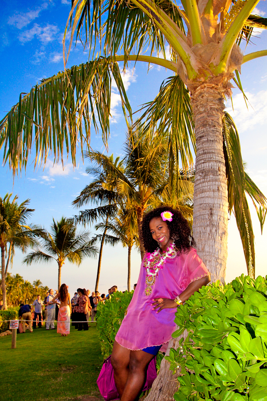 Chillin' under a palm tree at the Paradise Cove luau in Honolulu