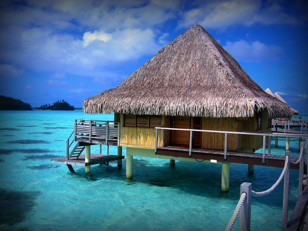 Overwater bungalow in Tahiti. Photo credit not found. TravelSeeLove.com does not claim any rights whatsoever to this image.