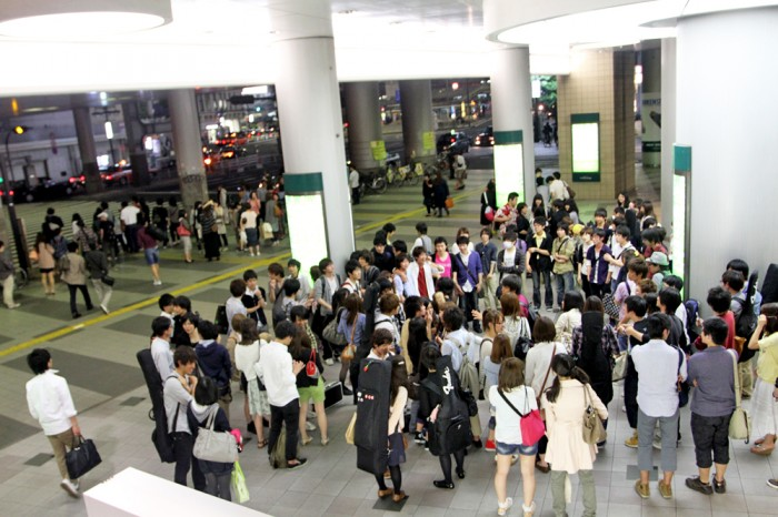 At the Shibuya station where a flash mob is getting ready to perform!