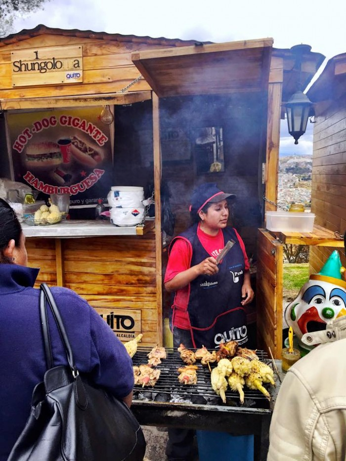 Meal time during a local festival in Quito, Ecuador